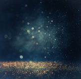 Glitter vintage lights background. gold, silver, blue and black. de-focused. Royalty Free Stock Photo
