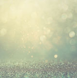 Glitter vintage lights background. gold, silver, blue and black. de-focused. Royalty Free Stock Photography