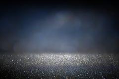 Glitter vintage lights background. gold, silver, blue and black. de-focused. Stock Image