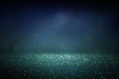 Glitter vintage lights background. gold, silver, blue and black. de-focused. Royalty Free Stock Image