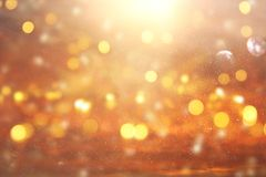 Glitter vintage lights background. gold and silver. de focused.  Stock Photo