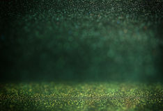 Glitter vintage lights background. gold, silver, green and black. de-focused. Royalty Free Stock Photo