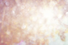 Glitter vintage lights background. gold, silver, and white. de-focused. Stock Photography