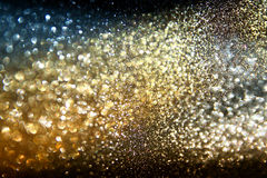 Glitter vintage lights background. light , blue, gold and black. defocused. Stock Images