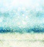 Glitter vintage lights background with light burst . silver, blue and white. de-focused. Stock Images