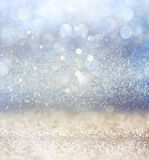 Glitter vintage lights background with light burst . silver, blue and white. de-focused. Stock Photos
