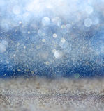 Glitter vintage lights background with light burst . silver, blue and white. de-focused. Royalty Free Stock Photography