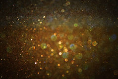 Glitter vintage lights background. light gold and black. Defocused Royalty Free Stock Images