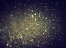 Glitter vintage lights background. light gold and black Stock Photo