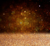 Glitter vintage lights background. light gold and black. defocused Royalty Free Stock Image