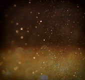 Glitter vintage lights background. light gold and black. defocused. Royalty Free Stock Images