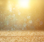 Glitter vintage lights background. light gold and black. defocused. stock photo