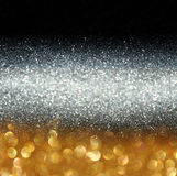 Glitter vintage lights background. light gold and black. defocused. Stock Image