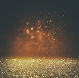 Glitter vintage lights background. light gold and black. defocused. Stock Photography