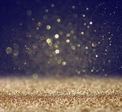 Glitter vintage lights background. light gold and black. defocused. Pic