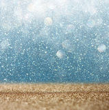 Glitter vintage lights background. light gold and blue. defocused. Royalty Free Stock Photography