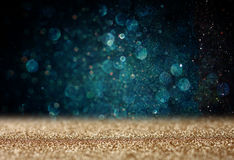 Glitter vintage lights background. light gold and blue. defocused. Stock Images