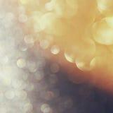 Glitter vintage lights background. light gold, silver and black. defocused. Stock Photo