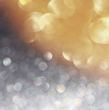 Glitter vintage lights background. light gold, silver and black. defocused. Royalty Free Stock Photos