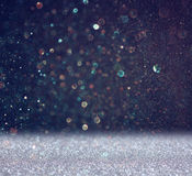 Glitter vintage lights background. light silver and black. defocused.