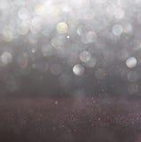 Glitter vintage lights background. light silver and black. defocused. Stock Image