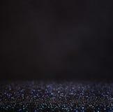 Glitter vintage lights background. light silver and black. defocused Stock Image