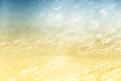 Glitter vintage lights background. light silver, gold, and blue. defocused. Royalty Free Stock Photography
