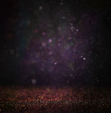 Glitter vintage lights background. light silver , gold, purple and black. defocused. Royalty Free Stock Photos