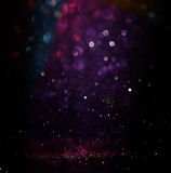 Glitter vintage lights background. light silver, purple, blue, gold and black. defocused.