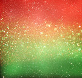 Glitter vintage lights background. red, gold and green. de-focused. Royalty Free Stock Images