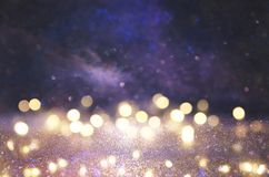 glitter vintage lights background. silver, black, purple and gold. de-focused. stock photography