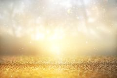 glitter vintage lights background. silver and gold. de-focused. stock photos