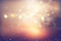 glitter vintage lights background. silver, pink, purple and gold. de-focused. stock photos