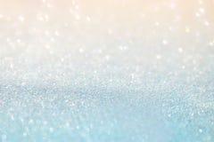 Glitter vintage white lights background. de-focused.  Royalty Free Stock Images