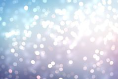 Glitter winter background. New year abstract bokeh texture. Christmas natural background. Snow silver sequins on background of fro. Stylish image for a variety royalty free stock image