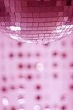 Glitterball. A glitterball with mirrored beads in background Royalty Free Stock Photography