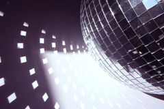 Glitterball and light shapes. A glitterball reflecting bright shapes on the floor stock photography