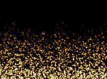 Glittering background. Gold glittering flake on black background Royalty Free Stock Photo