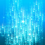 Glittering blue background. Bright glitters on a soft blue background Stock Photos