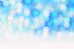 Glittering bokeh circular white on blue background and empty space for text. Glittering bokeh circular white on blue background Royalty Free Stock Images