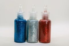 Glittering bottles with glue royalty free stock photo