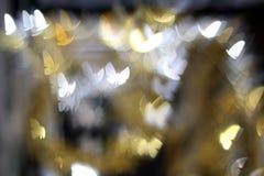 Glittering butterfly on bokeh background. Glittering butterfly on dark bokeh background Stock Image