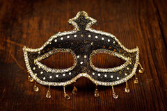 Glittering carnival mask on wooden table Stock Photography