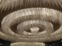 Glittering Chandelier. Awesome decoration of ceiling royalty free stock photography