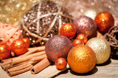 Glittering christmas decoration in orange and brown natural wood Royalty Free Stock Image
