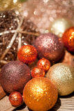 Glittering christmas decoration in orange and brown natural wood Stock Photo