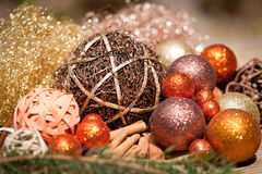 Glittering christmas decoration in orange and brown natural wood Royalty Free Stock Photo