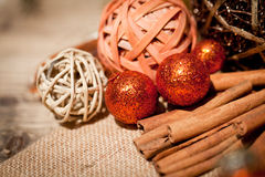 Glittering christmas decoration in orange and brown natural wood Stock Photos