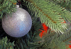 Glittering Christmas Ornament. A Glittering Christmas Ornament adorns a Christmas Tree royalty free stock image