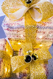 3 glittering christmas parcels, with big gold bows and bells Stock Images